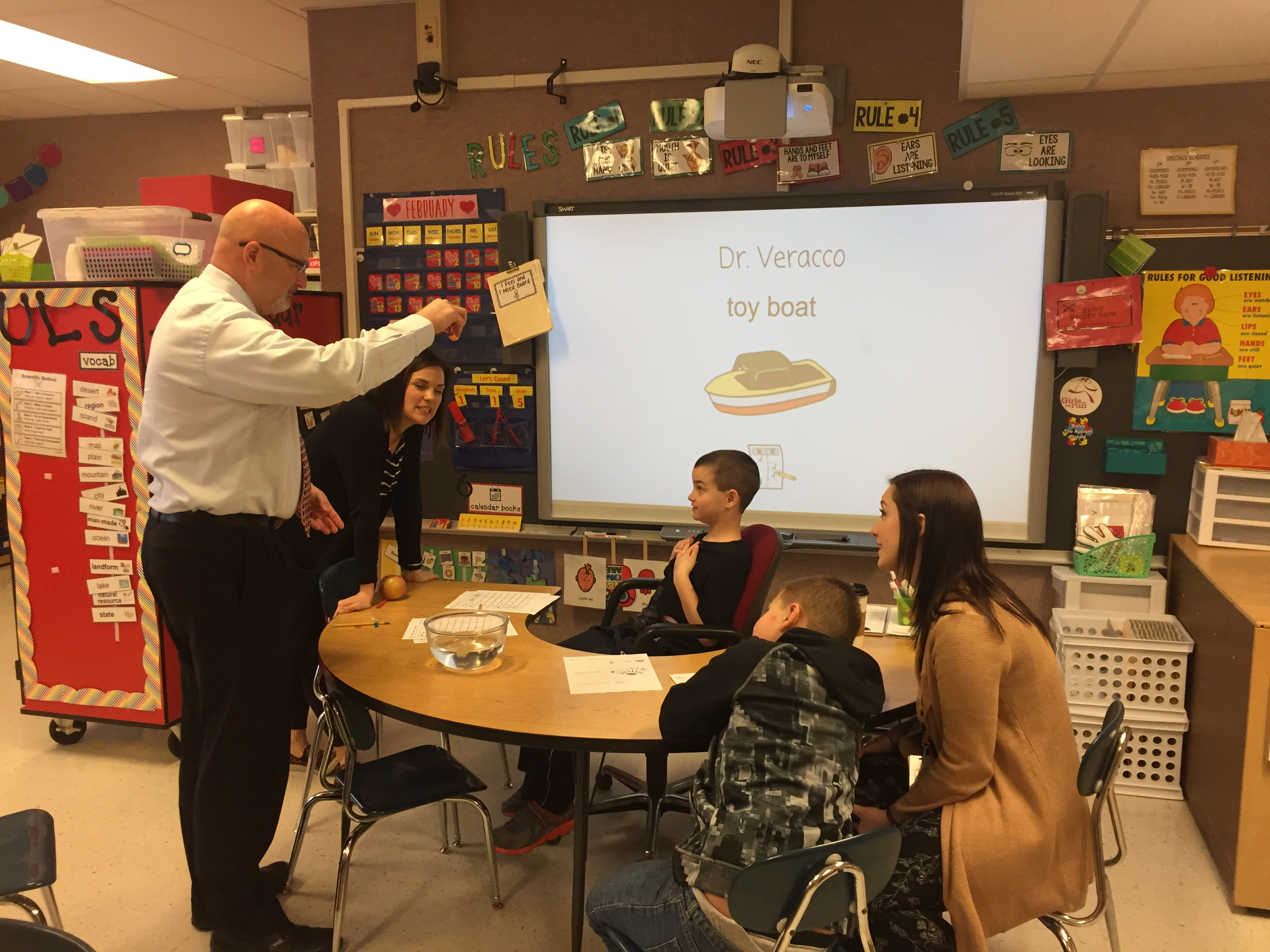 Dr. Veracco with Homan students.